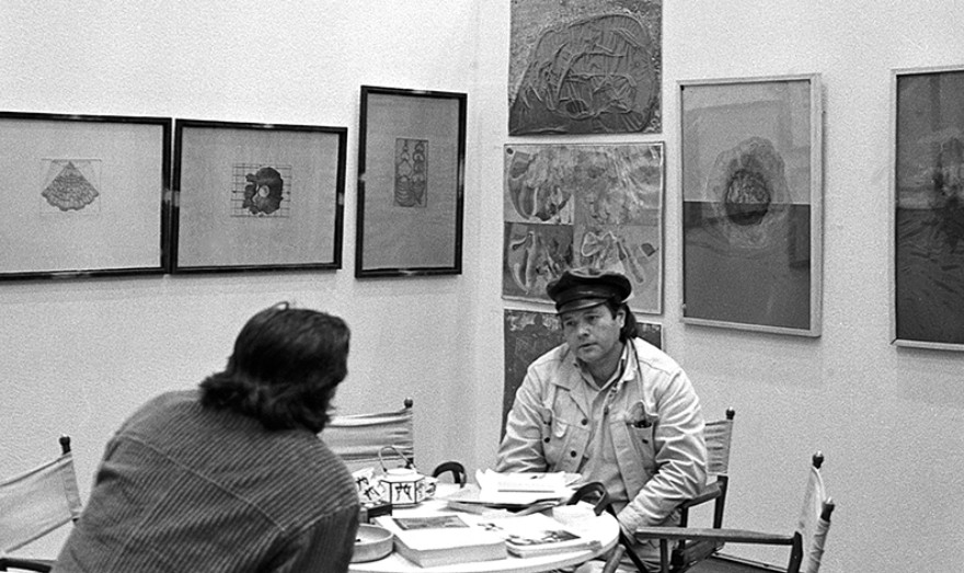 "Helmut Rywelski in his booth at the ""International Art and Information Fair"", Düsseldorf, 1972, photo: Anita Kloten"