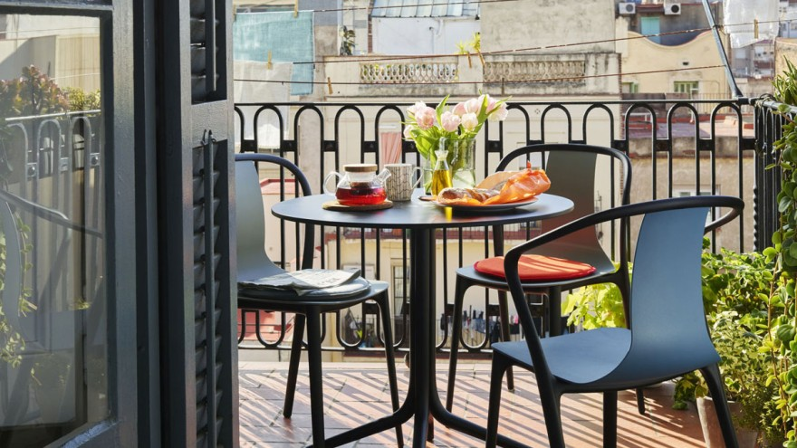 Create a small balcony with modern furniture