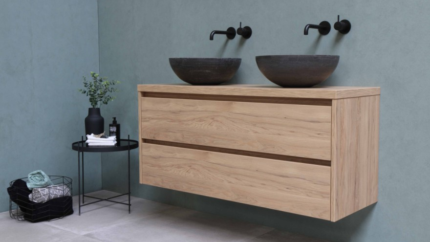 Sustainable bathroom with wooden furniture and nature stone