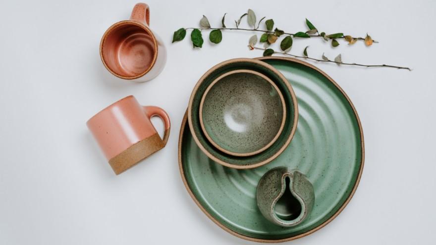 Handmade ceramic tableware, photographed by Toa Heftiba on Unsplash