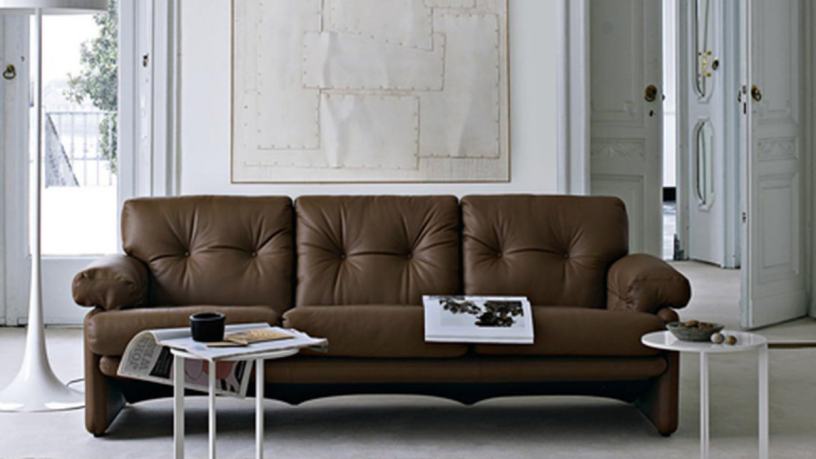 Living room with brown leather sofa and two small side tables