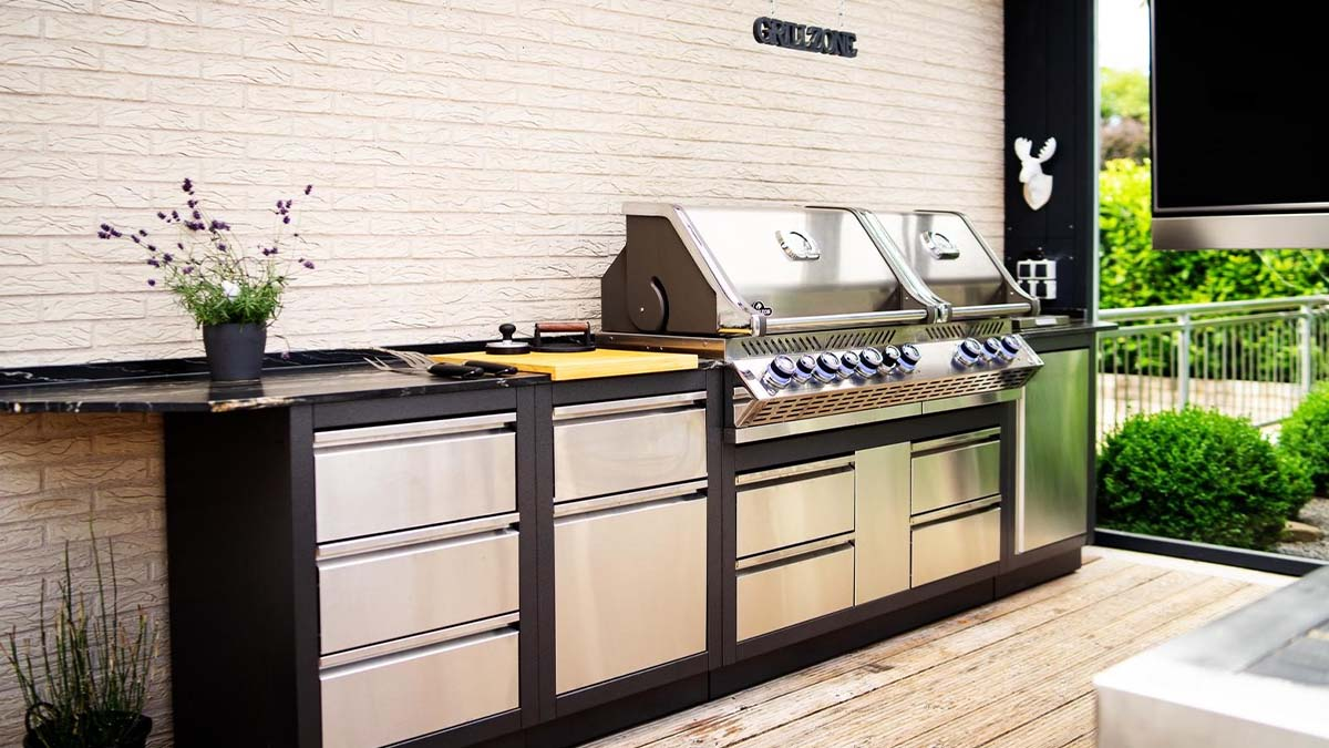 Napoleon Oasis modular outdoor kitchen with BiPro 825 built-in grill with four burners, infrared backburner, smoker chip burner and two infrared burners.