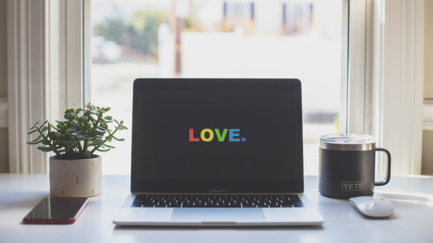 Laptop with LOVE screen in rainbow colors